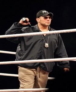 The Riddle Box: Wrestling: Officer Colt Cabana